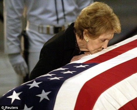 nancyreagankissingcoffin